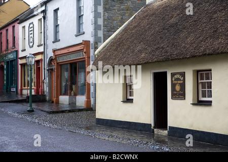 Old fashioned Irish street from 19th century at Bunratty folk park, County Clare, Ireland - Stock Photo