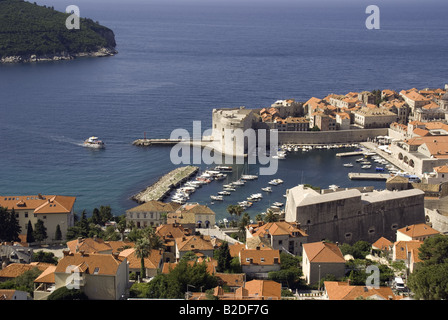 Dubrovnik Old Town, harbour of historic walled city on Adriatic with Lokrum Island above left - Stock Photo