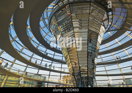 Glass dome and mirrored central glass funnel above the Plenary chamber of the Reichstag building Berlin Germany - Stock Photo