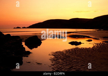 Sunset on Newgale Beach, Pembrokeshire, Wales, UK - Stock Photo