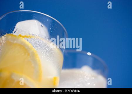 Glasses of lemonade in sunshine - Stock Photo