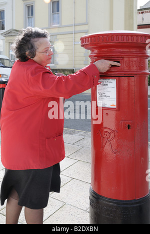 Post Office Red Victorian Pillar Box at the corner of Citadel Road and Athenaeum Street Plymouth England - Stock Photo