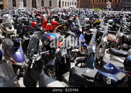 scooters vespas and motorbikes parked in piazza giacomo matteotti siena tuscany southern italy europe - Stock Photo