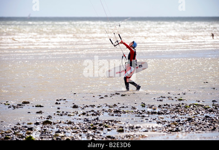 kite surfers on Goring beach near Worthing walking along the foreshore. Picture by Jim Holden. - Stock Photo