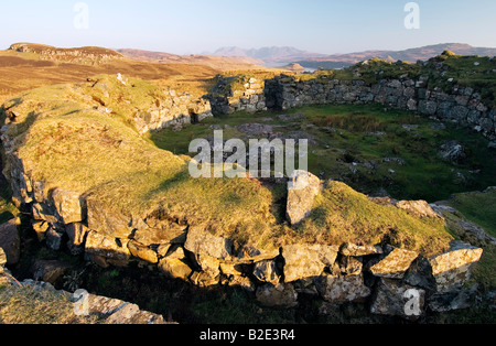 Double walled Dun Beag Broch 2000 year old circular settlement at Bracadale, Isle of Skye, Scotland. Cuillin mountains - Stock Photo