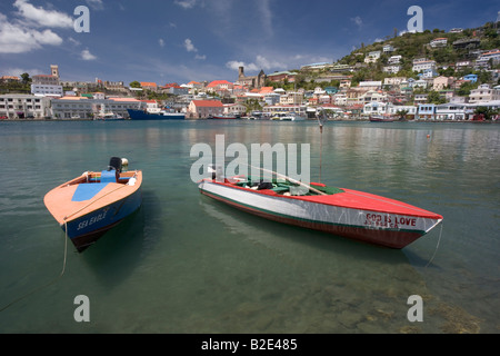The commercial harbor at St George s Grenada West Indies Small fishing skiffs are in the foreground - Stock Photo