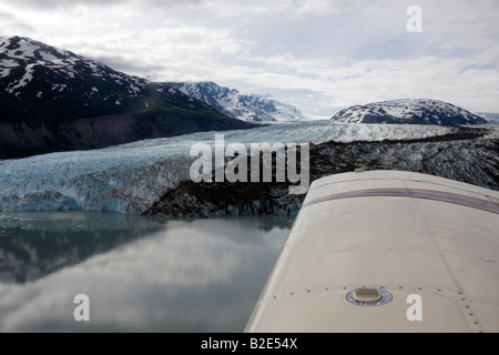 Flight seeing trip with a small air plane plane over the Knik River valley and Knik River Glacier, Alaska, USA - Stock Photo
