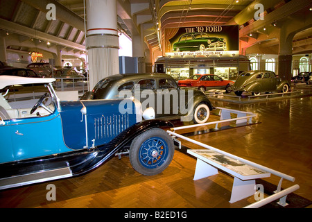 Ford automobiles on display at The Henry Ford Museum in Dearborn Michigan - Stock Photo