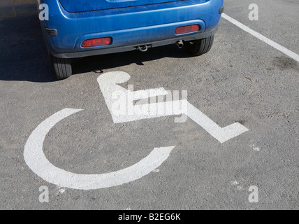 Car in disabled person parking space - Stock Photo