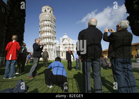 Tourists photographing The Leaning Tower, Pisa, Tuscany, Italy - Stock Photo