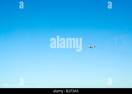 Airplane in flight John F Kennedy Airport New York City New York State USA North America - Stock Photo