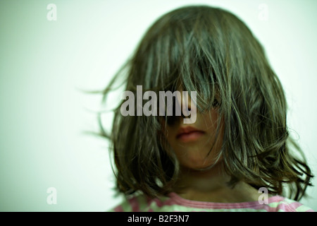 Five year old girl with messy hair - Stock Photo