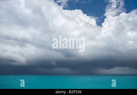 Dark rain clouds forming over the Caribbean Sea near St Martin in the Leeward Islands - Stock Photo