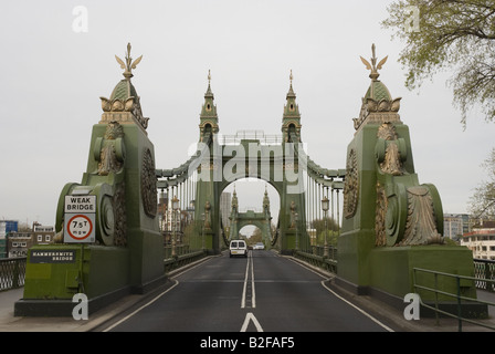 The approach to Hammersmith Bridge in London. - Stock Photo