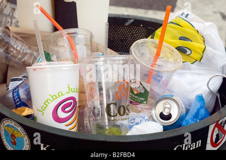 An full trash can in New York - Stock Photo