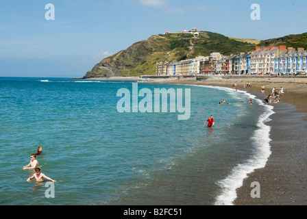 Aberystwyth Wales Ceredigion west coast mid Wales UK Seaside resort family on holiday Constitution Hill people swimming - Stock Photo