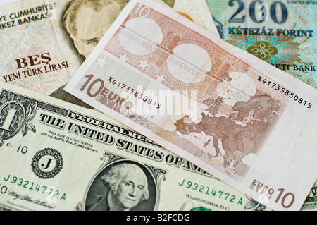 Various banknotes: 1 US Dollar, 10 Euro, 200 Hungarian Forints, Turkish Lira - Stock Photo