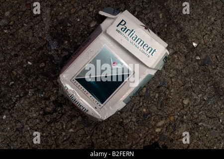 An empty pack of Parliament cigarettes is tossed away on the street in New York NY - Stock Photo
