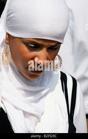 One girl young moslem muslim teen woman at street, Rotterdam Summer Carnival music caribbean festival, Netherlands - Stock Photo