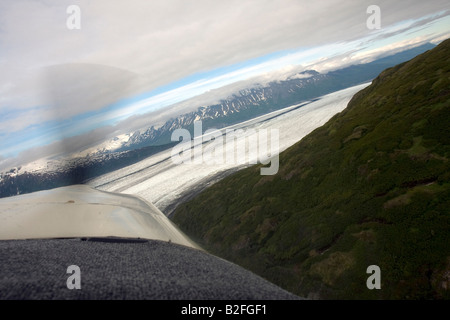 Flight seeing trip with small air plane plane over the Knik River valley towards Knik River Glacier, Palmer, Alaska, - Stock Photo