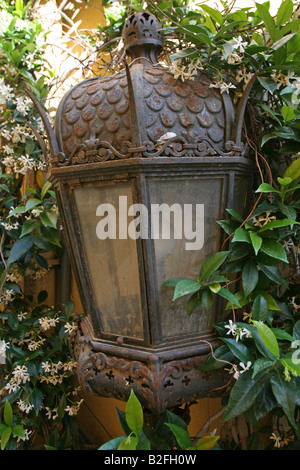 An ornate street lamp in the old town of St Tropez. - Stock Photo