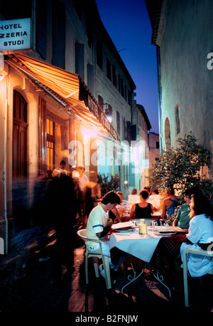 diners eating alfresco in french village arles - Stock Photo