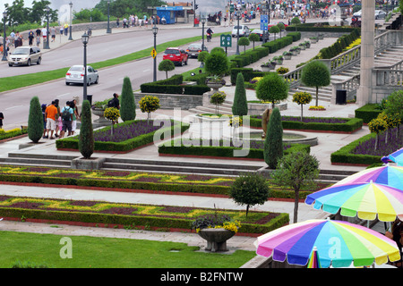 Tourists and formal gardens along Niagara River Parkway in Niagara Falls City Canada - Stock Photo