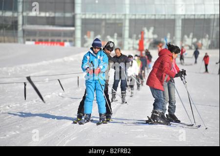 Chinese skiers at Yabuli Ski Resort 200km southeast of Harbin, Heilongjiang Province, China - Stock Photo