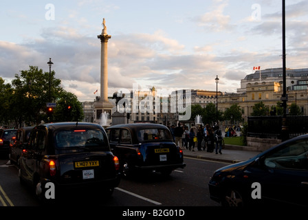 Trafalgar Square at sunset London England UK July 2008 Typical english cabs are jammed in the traffic - Stock Photo