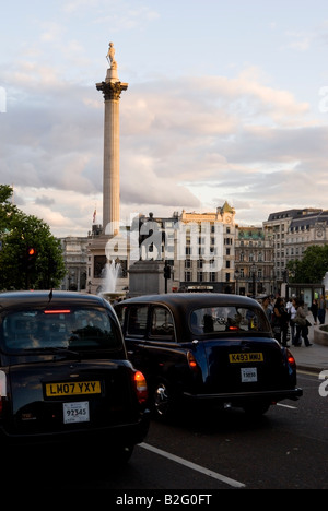 Trafalgar Square at sunset London England UK July 2008 Typical english cabs are jammed in the traffic. - Stock Photo
