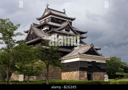 Matsue Castle in Shimane Prefecture is one of only a few remaining original wooden feudal castles in Japan - Stock Photo