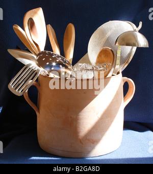 Kitchen Utensils in a terracotta pot. - Stock Photo