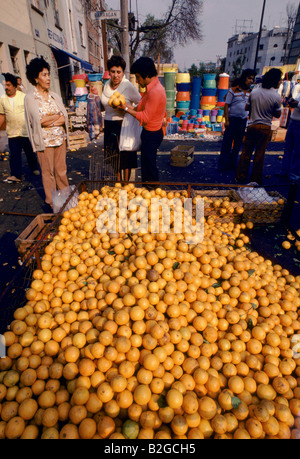 man selling oranges at a market mexico - Stock Photo