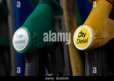 handles of city diesel and super unleaded fuel pumps at a garage service station county down northern ireland - Stock Photo