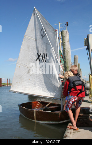 sailing trip boat child pier dinghy jolle kid - Stock Photo