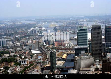 Aerial view of Canary Wharf London Docklands with London City Airport in the Distance - Stock Photo