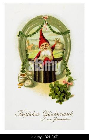 Postcard motive luck dwarf with horseshoe clover and money 19th century Germanyhorseshoe - Stock Photo