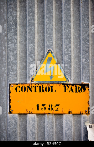 High voltage warning label in Cala Ratjada, Majorca, Spain - Stock Photo