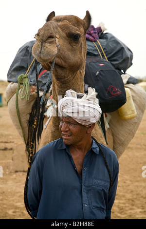 A CAMEL MAN leads tours in the THAR DESERT near JAISALMER RAJASTHAN INDIA MR - Stock Photo