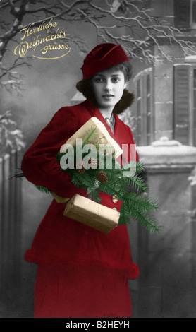 Postcard motive christmas woman in red 19th century Germany - Stock Photo