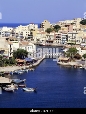 geography / travel, Greece, Crete, Agios Nikolaos, view of the town with a Lake Voulismeni, boat, fishing boat, - Stock Photo
