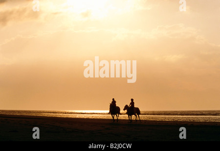 Riding on isle Norderney in the sunset Island Germany - Stock Photo