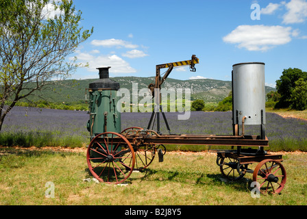 Old distill machine and lavender field in the Provence, France - Stock Photo