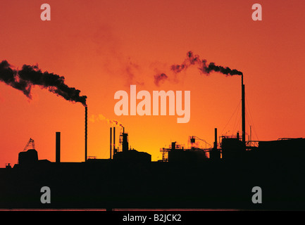 Australia. Refinery smokestacks emitting smoke. Sunset. - Stock Photo
