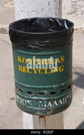 Litter bin in Malia Old Town on the Greek Mediterranean island of Crete GR EU - Stock Photo