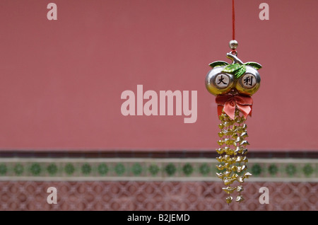 Ornate wind chime inside Thian Hock Keng Temple, the oldest Hokkien Chinese temple in Singapore - Stock Photo