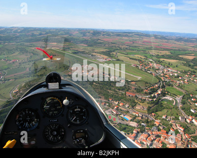 Pilot's eye view from a glider cockpit during flight near the airfield. Note the french rural landscape on a sunny - Stock Photo