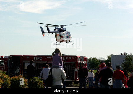 Flight for Life helicopter flying away from a Fire Safety Fair - Stock Photo