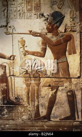 Seti I, circa 1323 - 1279 BC, King of Egypt 1290 BC - 1279 BC (19th Dynasty), sacrificing incence to God Osiris, - Stock Photo