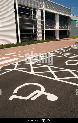 UK disability disabled parking place outside newly built office building - Stock Photo